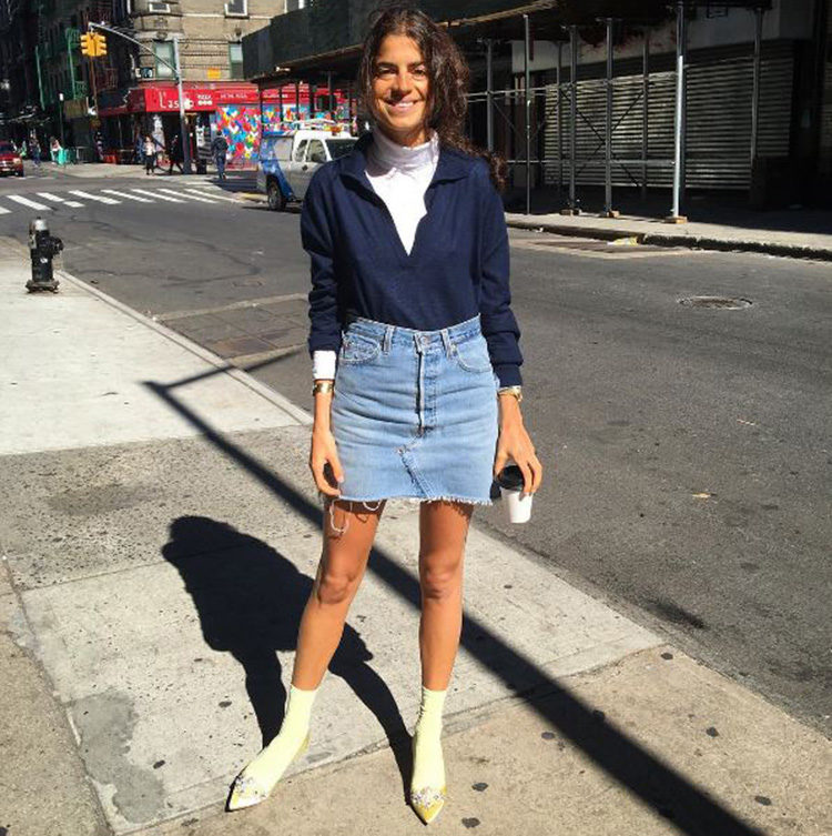 Out and about in New York, Leandra inspiring us all to go out and buy a denim skirt.