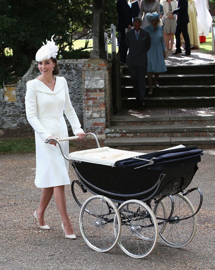 Catherine, Duchess of Cambridge, wears a white coat dress by Alexander McQueen, fascinator by Jane Taylor and Mappin & Wedd jewellery