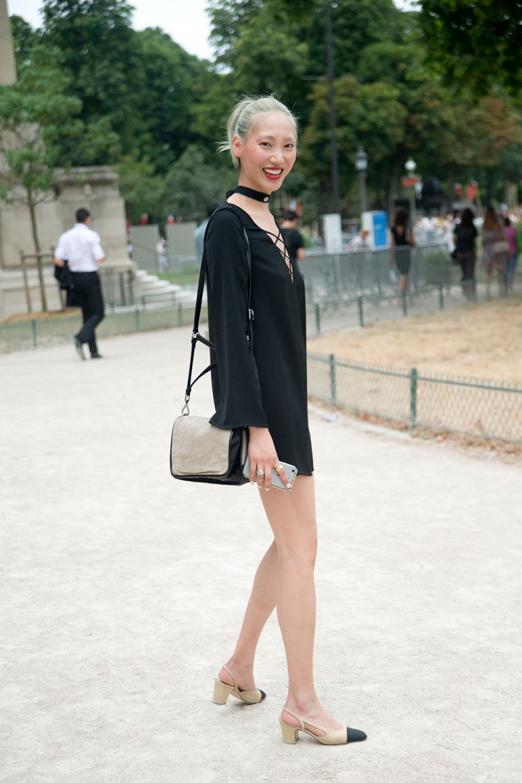 Model Soo Joo Park wears a vintage dress and Chanel shoes on day 3 of Paris Fashion Week Haute Couture Autumn/Winter 2015.