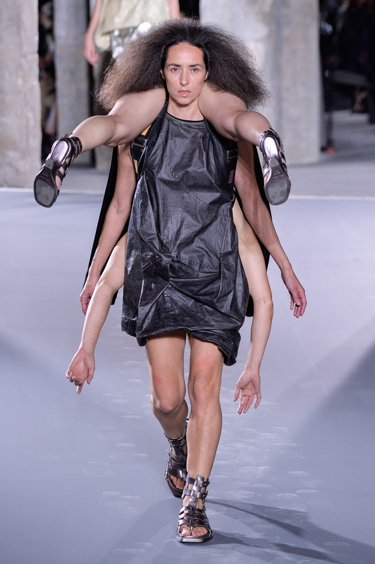 Models accessorised with other models at Rick Owens. The designer's show notes read: