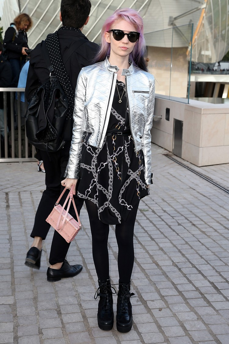 Singer Grimes arrives at the Louis Vuitton show.
