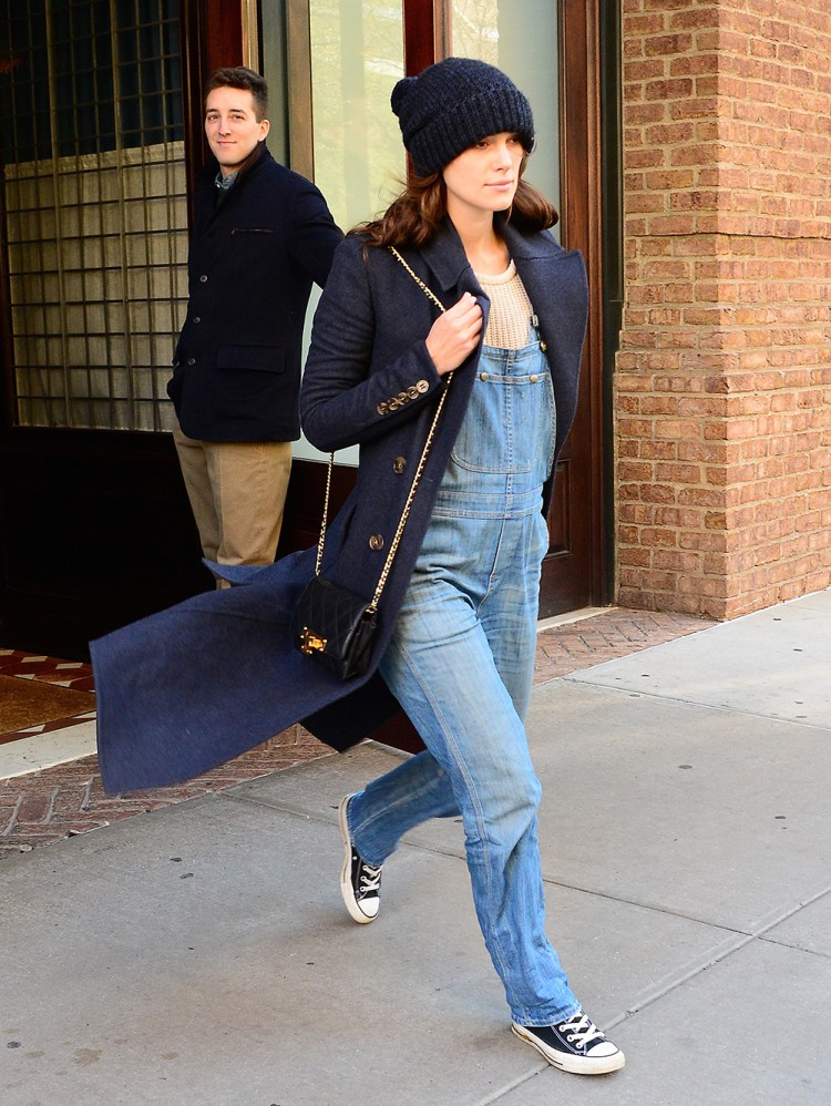 While there is still a slight chill in the air, Keira Knightley adds a knitted jumper, hat and coat to her dungaree ensemble. Photo / Getty Images