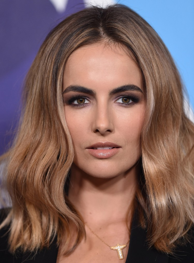 If Cara or Lily's full, flat brows aren't achievable, Camilla Belle's bold but more natural-looking brows could be your answer?