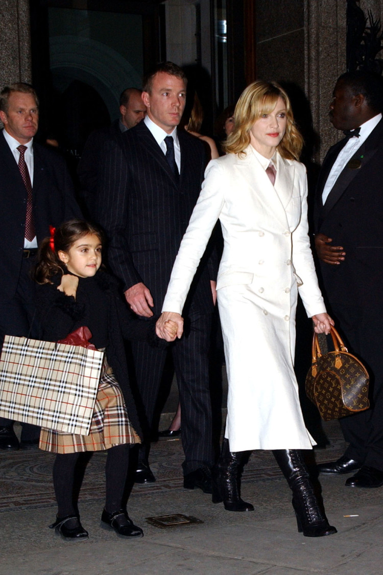 Madonna, Guy Ritchie and daughter Lourdes, London, 2002.