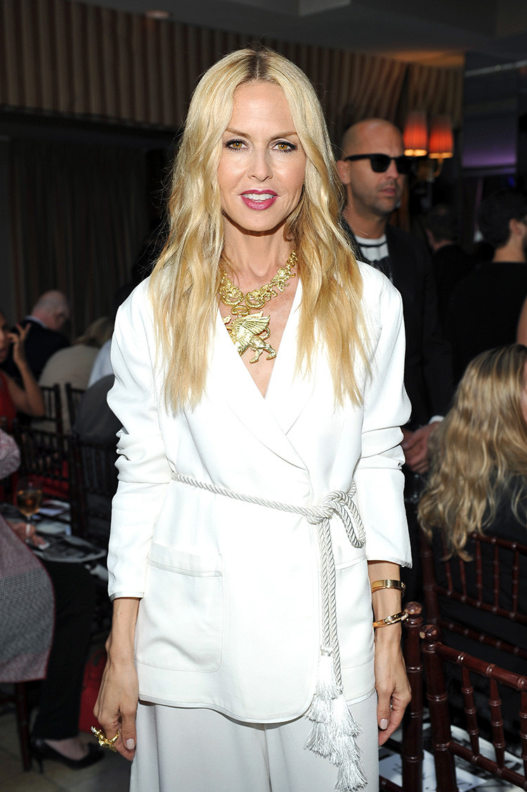 Stylist to the stars Rachel Zoe exudes glamour in a white blazer and rope belt with her signature over-sized gold jewellery.
