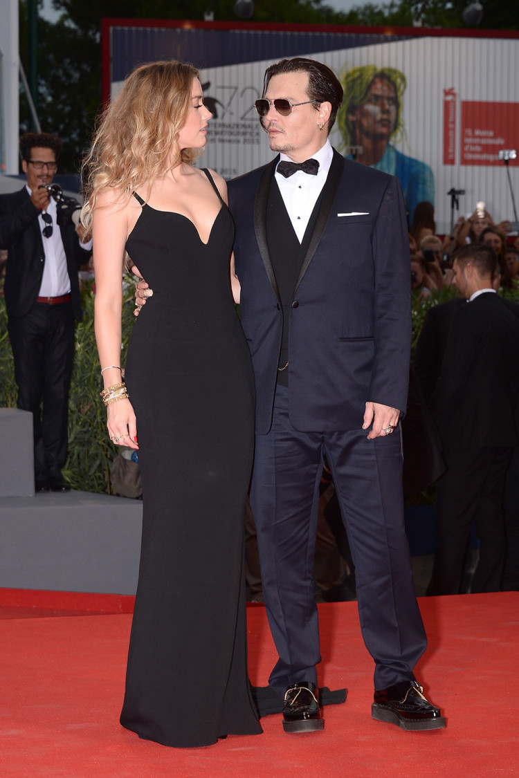 Amber and Johnny can't take their eyes off each other at the Black Mass premiere during the 72nd Venice Film Festival in September, 2015.