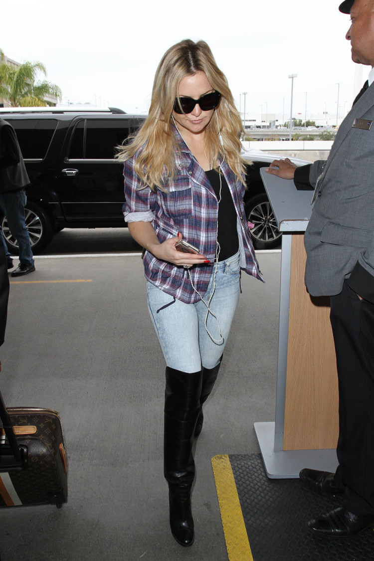 Kate Hudson departing LAX in a relaxed combo of blue jeans, a plaid shirt and over the knee boots.