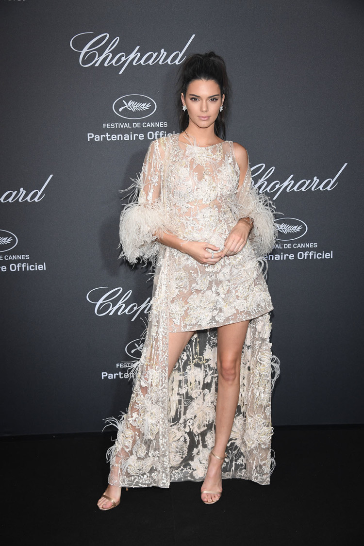 It girl and model Kendall Jenner dazzled in this white feather Elie Saab gown at the Chopard Wild Party in Cannes.