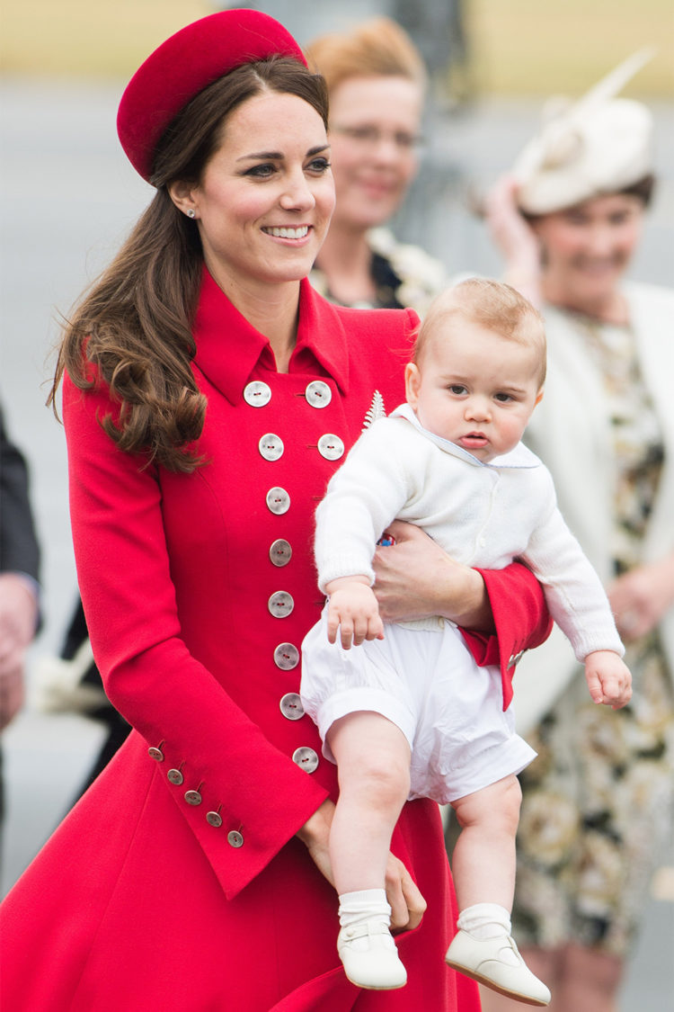Prince George touching down in Wellington, New Zealand, for his first official royal tour with his mother, who wore a red Catherine Walker coat and the Queen's diamond silver fern brooch on April 7, 2014.