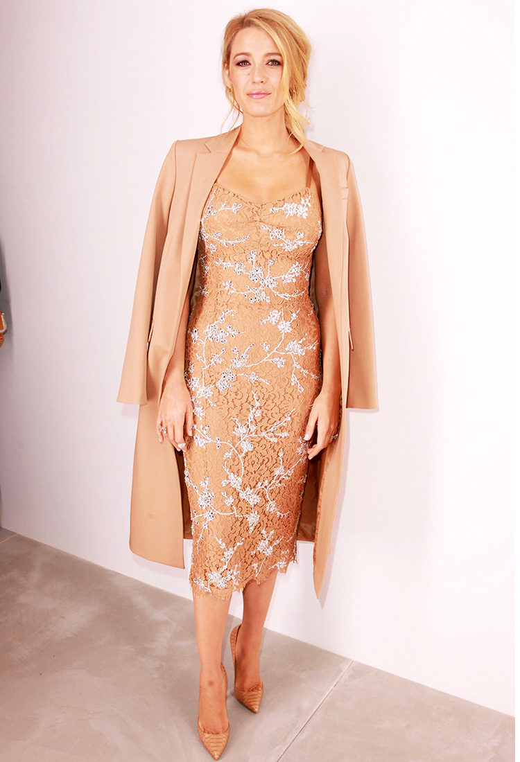 Blake Lively backstage at Michael Kors wearing a lace dress by Michael Kors Collection