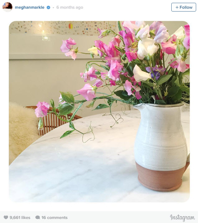 Fresh sweet peas in an earthenware vase give Meghan's old home a feminine feel.