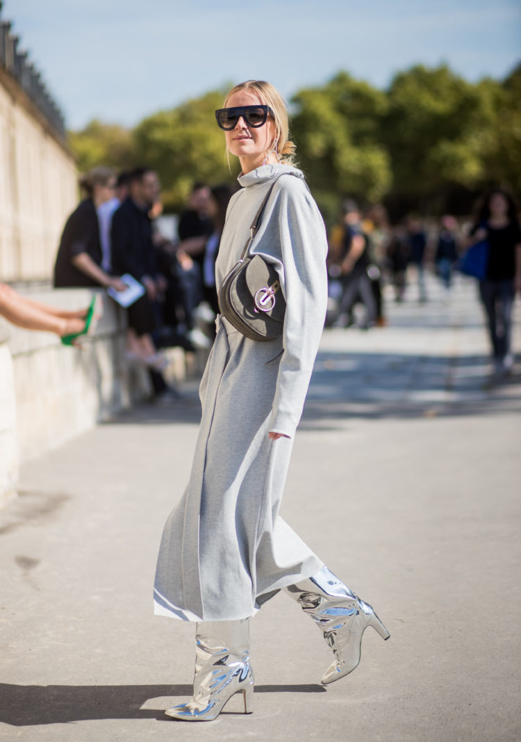 PARIS, FRANCE - SEPTEMBER 29: Celine Aagaard wearing silver boots, grey dress is seen outside Nina Ricci during Paris Fashion Week Spring/Summer 2018 on September 29, 2017 in Paris, France. (Photo by Christian Vierig/Getty Images)