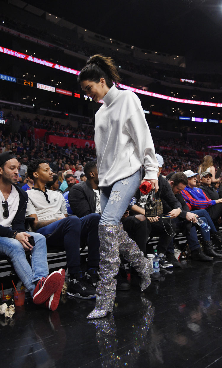 LOS ANGELES, CA - NOVEMBER 4: Kendall Jenner wearing a pair of $10,000 Saint Laurent boots attends the LA Clippers and Memphis Grizzlies basketball game at Staples Center November 4 2017, in Los Angeles, California. (Photo by Kevork Djansezian/Getty Images)