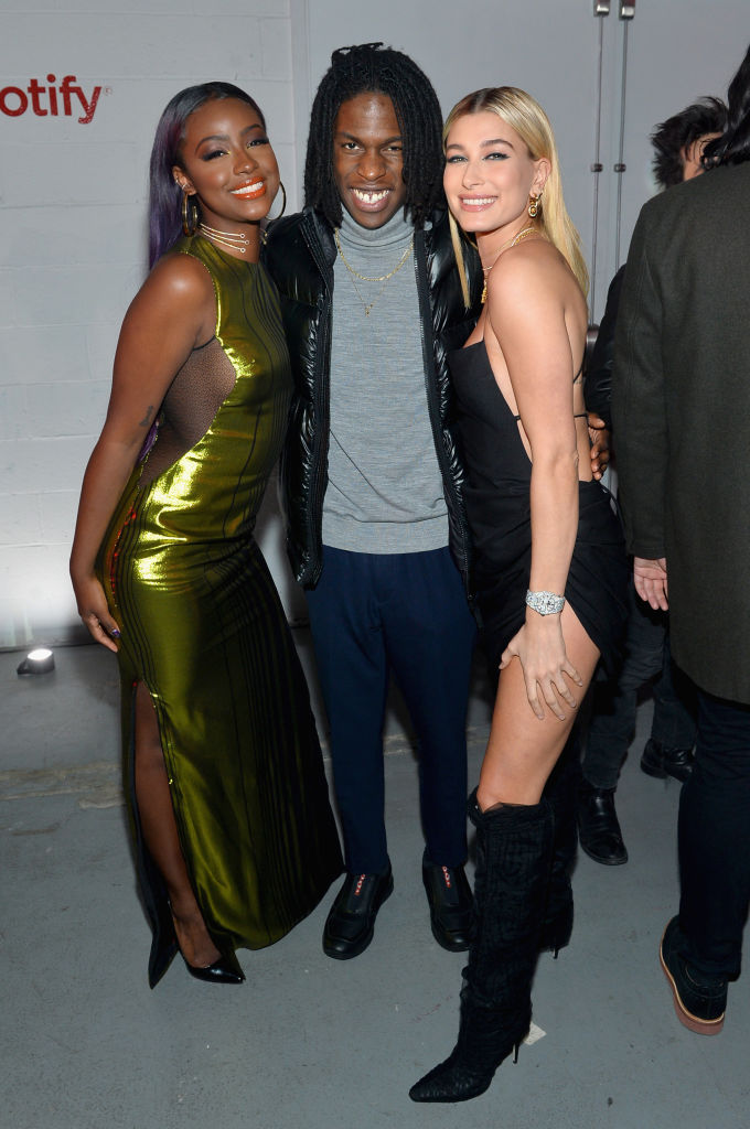 NEW YORK, NY - JANUARY 25: (L-R) Justine Skye, Daniel Caesar and Hailey Baldwin attend