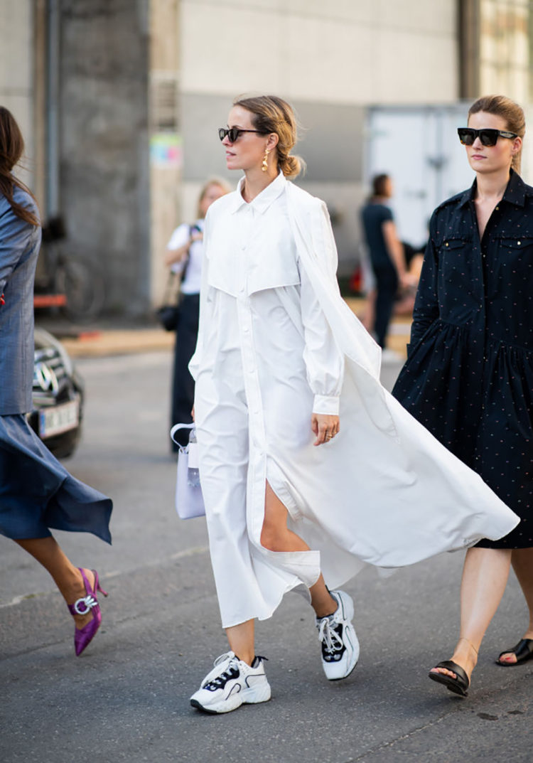 COPENHAGEN, DENMARK - AUGUST 09: A guest wearing white dress is seen outside Ganni during the Copenhagen Fashion Week Spring/Summer 2019 on August 9, 2018 in Copenhagen, Denmark. (Photo by Christian Vierig/Getty Images)