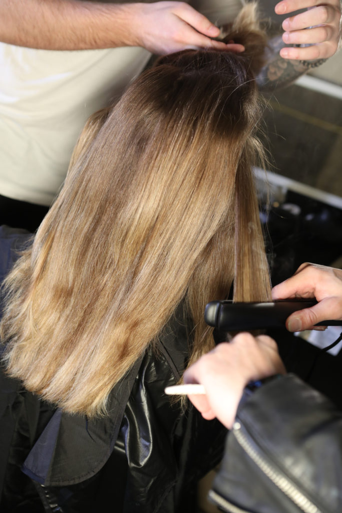 Backstage at Dion Lee's AW19 runway show at New York Fashion Week, hairstylist Eugene Souleiman shows us how to recreate the gothic romantic hairstyle.