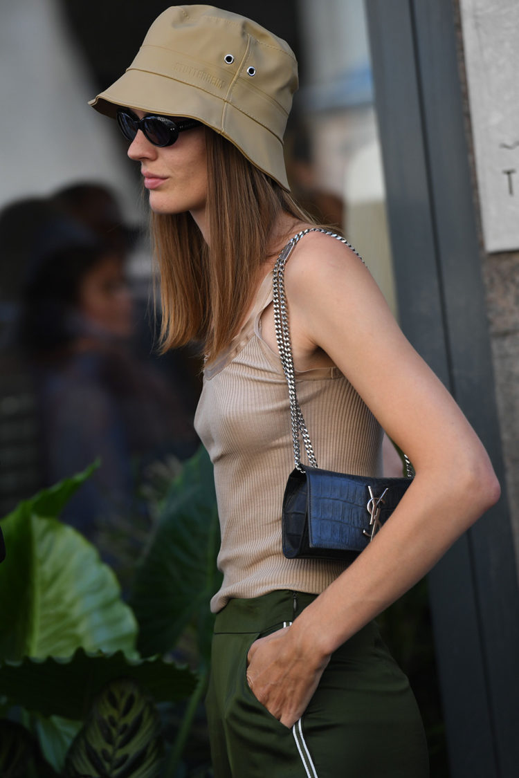 10 street style moments that prove the bucket hat trend is an instant outfit game-changer | Mandatory Credit: Photo by REX/Shutterstock (9786496at) Street Style Street Style, Spring Summer 2019, Copenhagen Fashion Week, Denmark - 07 Aug 2018