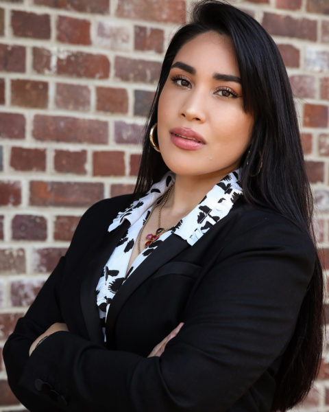 Lawyer and model Lanu Faletau wearing a patterned shirt and black blazer