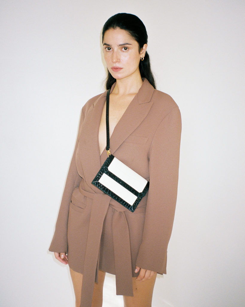 Mini bag by Paris Georgia x By Far, and model in a brown blazer