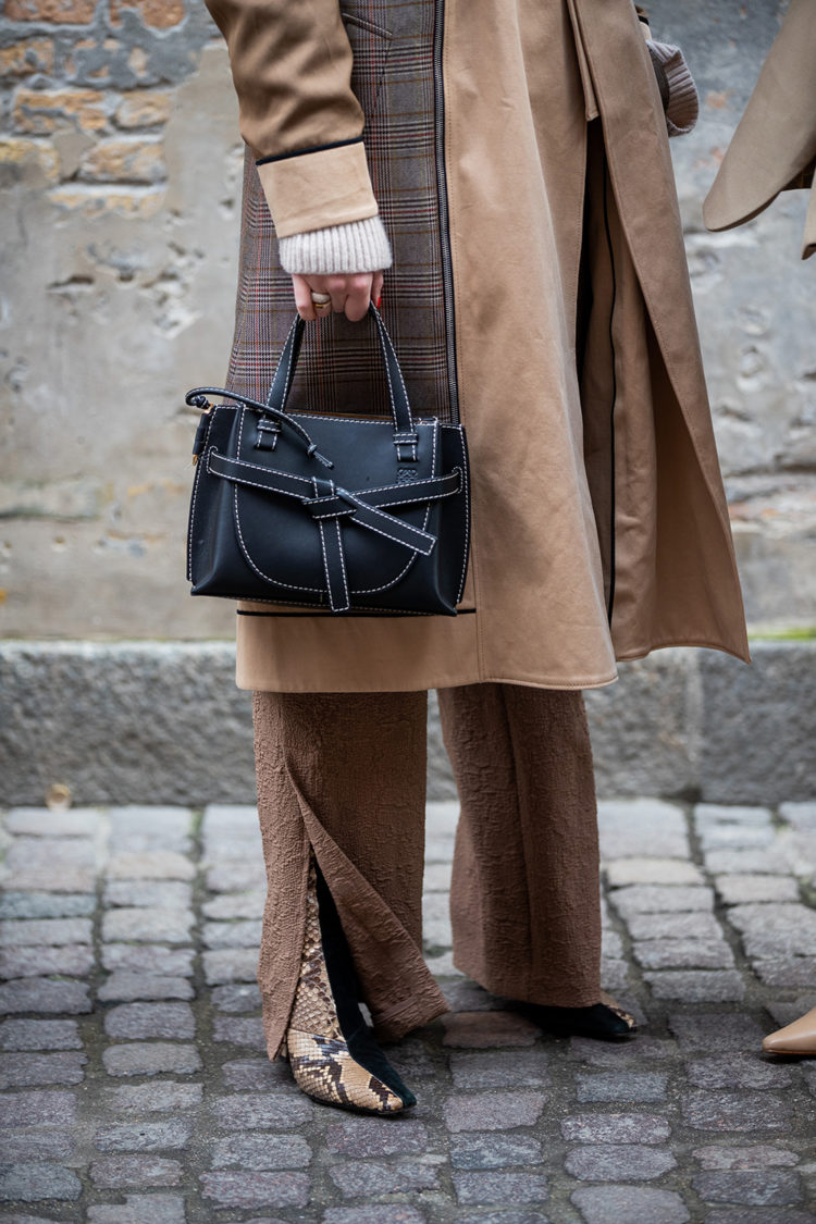 COPENHAGEN, DENMARK - JANUARY 29: Darja Barannik seen wearing beige brown two tone coat, black Loewe bag outside Mark Kenly Domino Tanduring Copenhagen Fashion Week Autumn/Winter 2020 Day 2 on January 29, 2020 in Copenhagen, Denmark. (Photo by Christian Vierig/Getty Images)