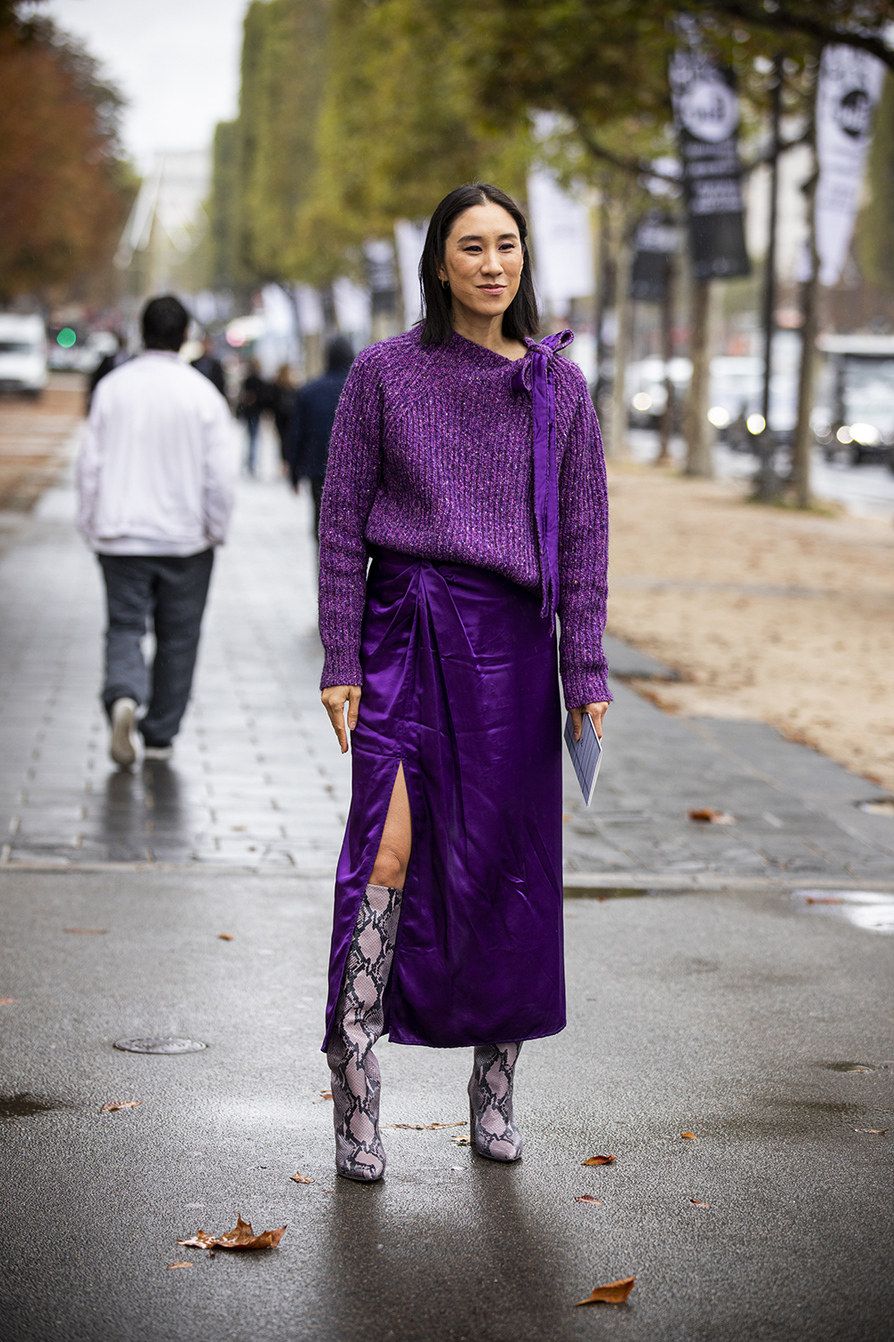 PARIS, FRANCE - OCTOBER 01: Eva Chen, wearing a purple sweater, purple skirt and snake print boots, is seen outside the Chanel show during Paris Fashion Week - Womenswear Spring Summer 2020 on October 01, 2019 in Paris, France. (Photo by Claudio Lavenia/Getty Images)